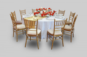 Winchester Round Banquet Table with White Regular Cover and Gold Chiavari Chairs