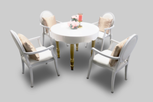 avalon curved round gold dining table setup with white dior dining armchairs 2 1 300x201 - Avalon Chic Round Gold Dining Table